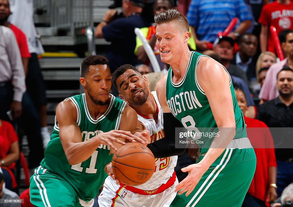 Thabo Sefolosha #25 of the Atlanta Hawks reaches for a steal as Jonas Jerebko #8 hands the ball off to Evan Turner #11 of the Boston Celtics in Game Five of the Eastern Conference Quarterfinals during the 2016 NBA Playoffs at Philips Arena on April 26, 2016 in Atlanta, Georgia. NOTE TO USER User expressly acknowledges and agrees that, by downloading and or using this photograph, user is consenting to the terms and conditions of the Getty Images License Agreement.