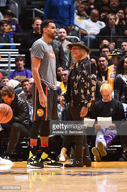 Thabo Sefolosha of the Atlanta Hawks talks to NBA Superfan James Goldstein before the game against the Los Angeles Lakers on November 27 2016 at...