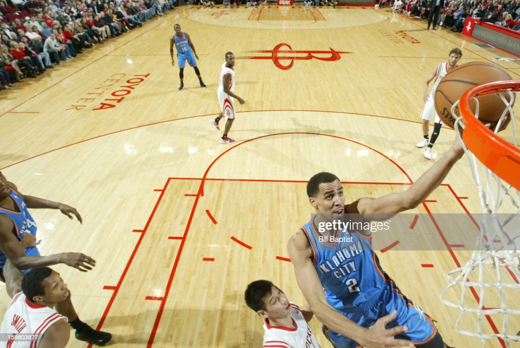 Thabo Sefolosha #2 of the Oklahoma City Thunder battle shoots the ball against the Houston Rockets on December 29, 2012 at the Toyota Center in Houston, Texas.