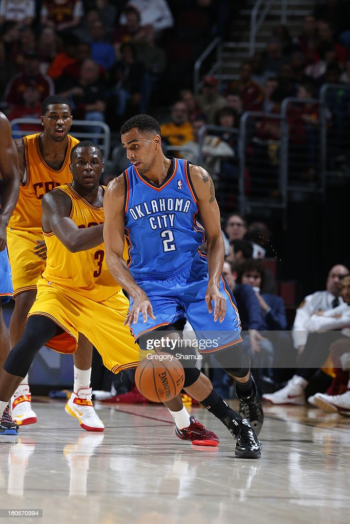 Thabo Sefolosha #2 of the Oklahoma City Thunder drives against Dion Waiters #3 of the Cleveland Cavaliers at The Quicken Loans Arena on February 2, 2013 in Cleveland, Ohio.