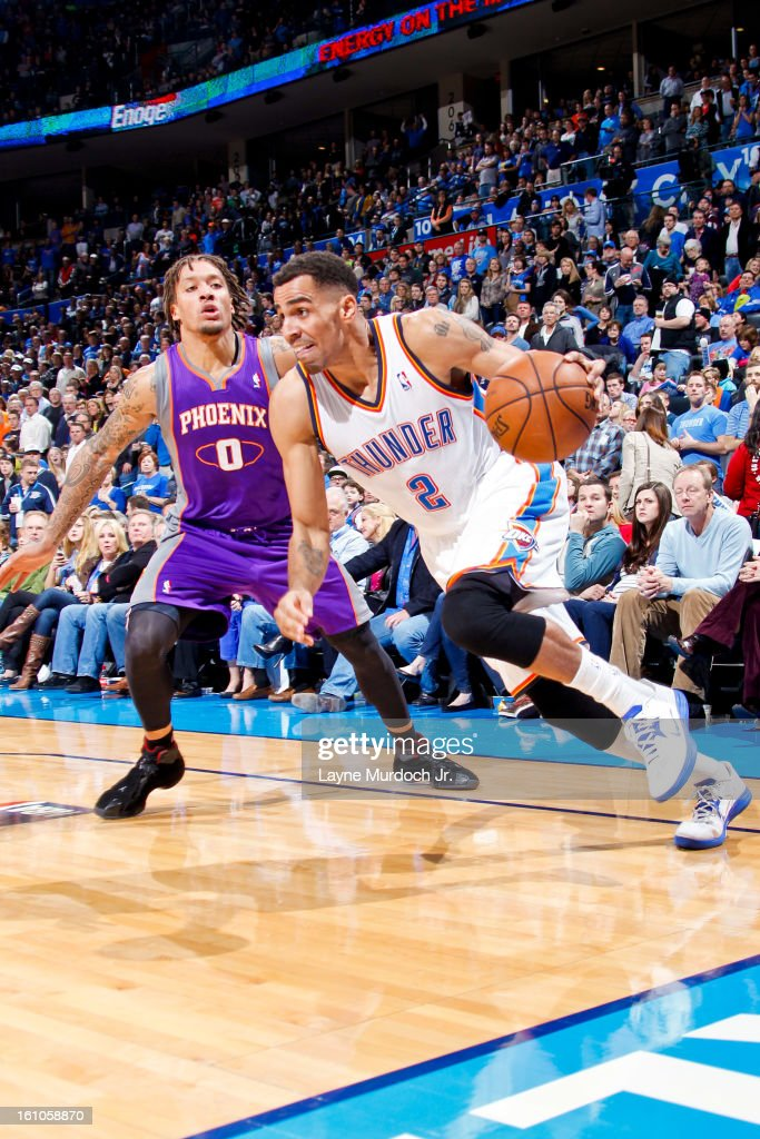 <a gi-track='captionPersonalityLinkClicked' href=/galleries/search?phrase=Thabo+Sefolosha&family=editorial&specificpeople=587449 ng-click='$event.stopPropagation()'>Thabo Sefolosha</a> #2 of the Oklahoma City Thunder drives against <a gi-track='captionPersonalityLinkClicked' href=/galleries/search?phrase=Michael+Beasley&family=editorial&specificpeople=4135134 ng-click='$event.stopPropagation()'>Michael Beasley</a> #0 of the Phoenix Suns on February 8, 2013 at the Chesapeake Energy Arena in Oklahoma City, Oklahoma.