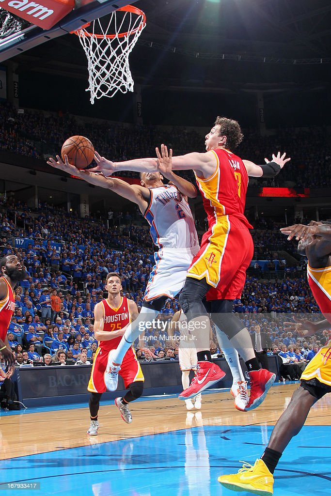 Thabo Sefolosha #2 of the Oklahoma City Thunder drives to the basket and gets his shot blocked by Omer Asik #3 of the Houston Rockets in Game Five of the Western Conference Quarterfinals during the 2013 NBA Playoffs on May 1, 2013 at the Chesapeake Energy Arena in Oklahoma City, Oklahoma.