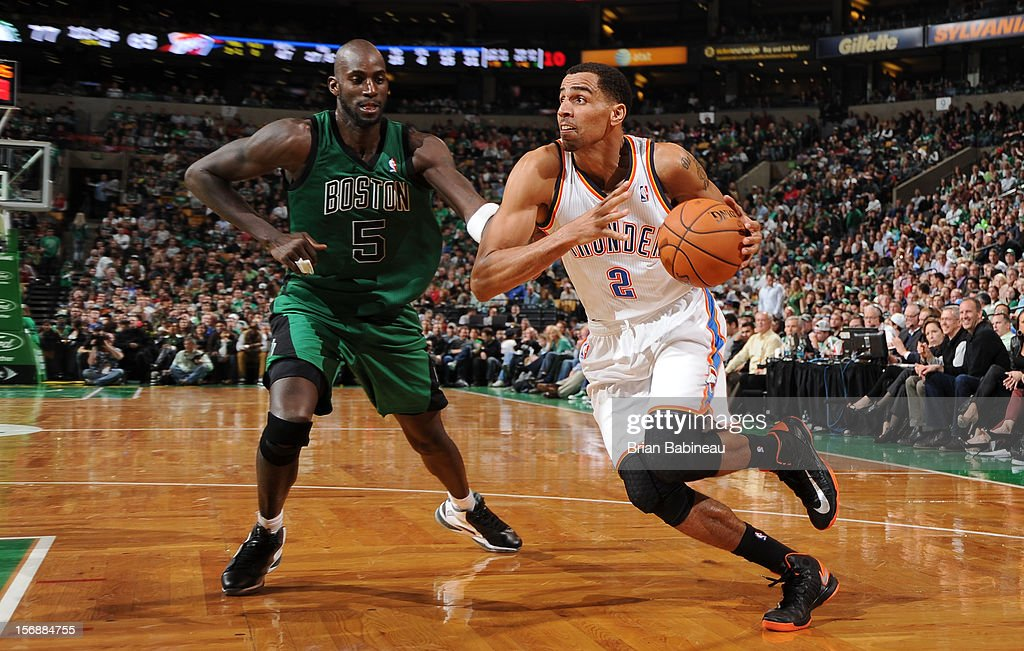 Thabo Sefolosha #2 of the Oklahoma City Thunder drives to the basket against Kevin Garnett #5 of the Boston Celtics on November 23, 2012 at the TD Garden in Boston, Massachusetts.