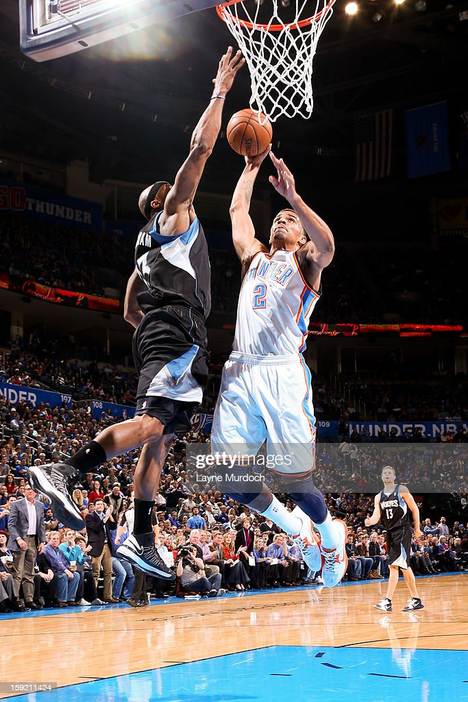 Thabo Sefolosha #2 of the Oklahoma City Thunder drives to the basket against Dante Cunningham #33 of the Minnesota Timberwolves on January 9, 2013 at the Chesapeake Energy Arena in Oklahoma City, Oklahoma.