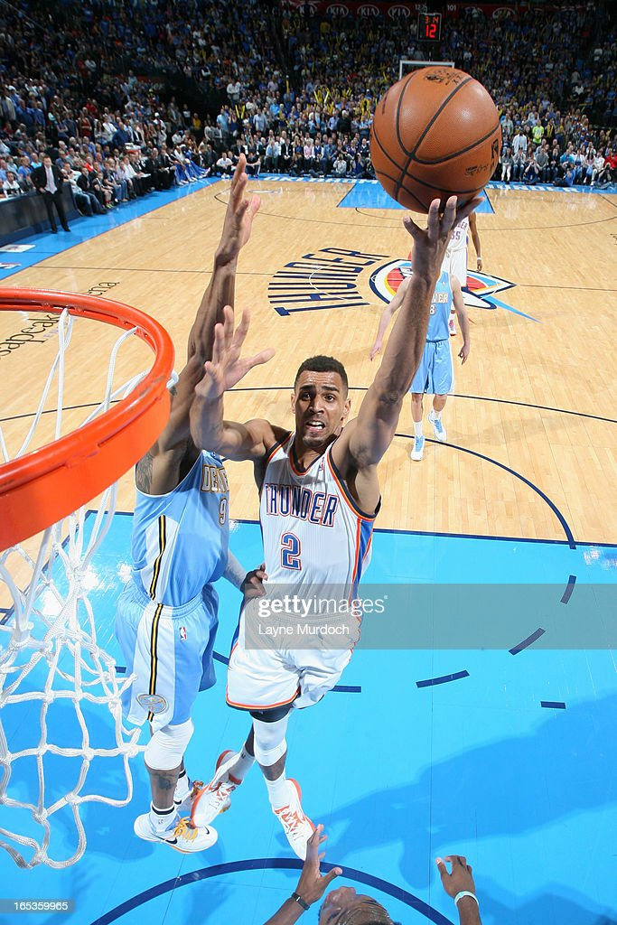 Thabo Sefolosha #2 of the Oklahoma City Thunder drives to the basket against the Denver Nuggets on March 19, 2013 at the Chesapeake Energy Arena in Oklahoma City, Oklahoma.