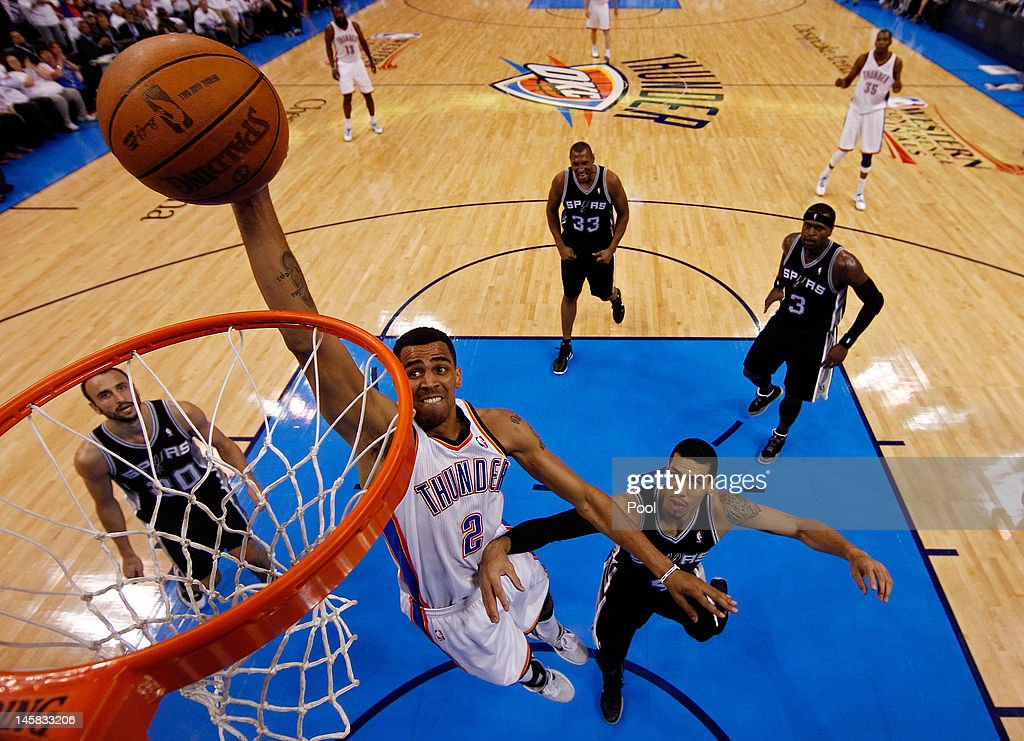 <a gi-track='captionPersonalityLinkClicked' href=/galleries/search?phrase=Thabo+Sefolosha&family=editorial&specificpeople=587449 ng-click='$event.stopPropagation()'>Thabo Sefolosha</a> #2 of the Oklahoma City Thunder dunks the ball against Daniel Green #4 and Manu Ginobili #20 of the San Antonio Spurs in Game Six of the Western Conference Finals of the 2012 NBA Playoffs at Chesapeake Energy Arena on June 6, 2012 in Oklahoma City, Oklahoma.