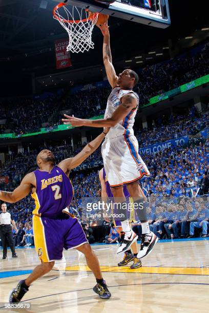 Thabo Sefolosha of the Oklahoma City Thunder goes to the basket over Derek Fisher of the Los Angeles Lakers in Game Six of the Western Conference...