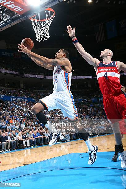 Thabo Sefolosha of the Oklahoma City Thunder goes up for the shot against the the Washington Wizards during an NBA game on November 10 2013 at the...