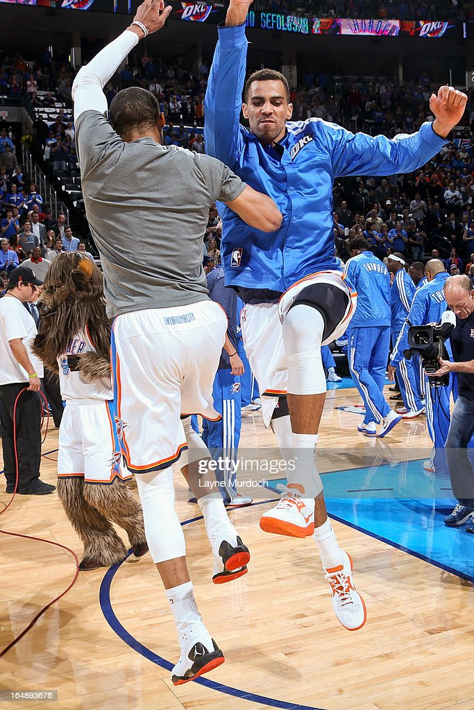 <a gi-track='captionPersonalityLinkClicked' href=/galleries/search?phrase=Thabo+Sefolosha&family=editorial&specificpeople=587449 ng-click='$event.stopPropagation()'>Thabo Sefolosha</a> #2 of the Oklahoma City Thunder greets teammates before playing against the Washington Wizards on March 27, 2013 at the Chesapeake Energy Arena in Oklahoma City, Oklahoma.