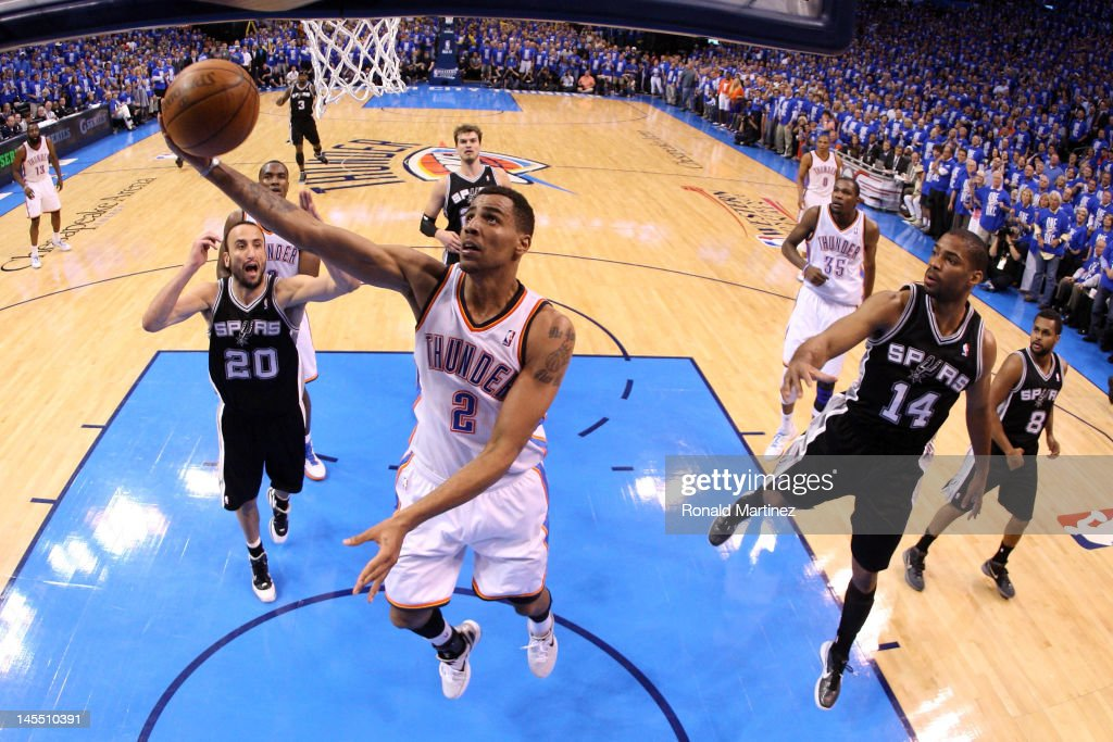 <a gi-track='captionPersonalityLinkClicked' href=/galleries/search?phrase=Thabo+Sefolosha&family=editorial&specificpeople=587449 ng-click='$event.stopPropagation()'>Thabo Sefolosha</a> #2 of the Oklahoma City Thunder lays the ball up against <a gi-track='captionPersonalityLinkClicked' href=/galleries/search?phrase=Gary+Neal&family=editorial&specificpeople=5085165 ng-click='$event.stopPropagation()'>Gary Neal</a> #14 of the San Antonio Spurs in Game Three of the Western Conference Finals of the 2012 NBA Playoffs at Chesapeake Energy Arena on May 31, 2012 in Oklahoma City, Oklahoma.
