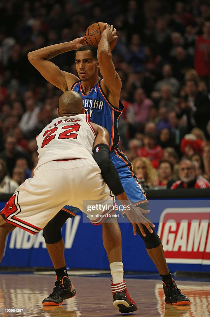 Thabo Sefolosha #2 of the Oklahoma City Thunder looks to pass over Taj Gibson #22 of the Chicago Bulls at the United Center on November 8, 2012 in Chicago, Illinois.The Thunder defeated the Bulls 97-91.