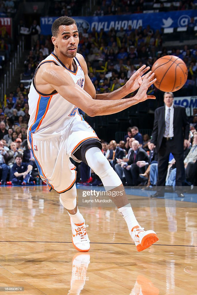 <a gi-track='captionPersonalityLinkClicked' href=/galleries/search?phrase=Thabo+Sefolosha&family=editorial&specificpeople=587449 ng-click='$event.stopPropagation()'>Thabo Sefolosha</a> #2 of the Oklahoma City Thunder passes the ball against the Washington Wizards on March 27, 2013 at the Chesapeake Energy Arena in Oklahoma City, Oklahoma.