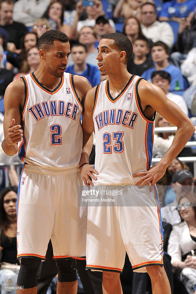 Thabo Sefolosha #2 of the Oklahoma City Thunder shares a word with teammate Kevin Martin #23 during the game against the Orlando Magic on March 22, 2013 at Amway Center in Orlando, Florida.