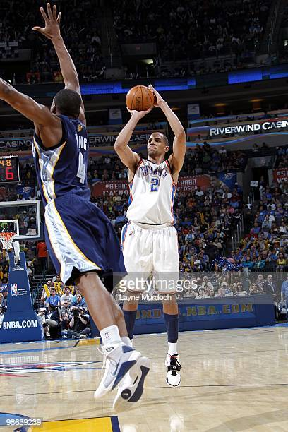 Thabo Sefolosha of the Oklahoma City Thunder shoots a jump shot against Sam Young of the Memphis Grizzlies during the game at Ford Center on April 14...