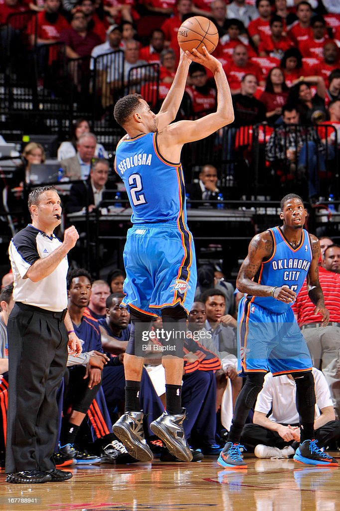 <a gi-track='captionPersonalityLinkClicked' href=/galleries/search?phrase=Thabo+Sefolosha&family=editorial&specificpeople=587449 ng-click='$event.stopPropagation()'>Thabo Sefolosha</a> #2 of the Oklahoma City Thunder shoots a three-pointer against the Houston Rockets in Game Four of the Western Conference Quarterfinals during the 2013 NBA Playoffs on April 29, 2013 at the Toyota Center in Houston, Texas.