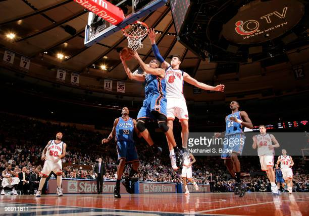 Thabo Sefolosha of the Oklahoma City Thunder shoots against Danilo Gallinari of the New York Knicks on February 20 2010 at Madison Square Garden in...