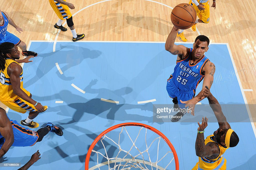 <a gi-track='captionPersonalityLinkClicked' href=/galleries/search?phrase=Thabo+Sefolosha&family=editorial&specificpeople=587449 ng-click='$event.stopPropagation()'>Thabo Sefolosha</a> #25 of the Oklahoma City Thunder shoots against the Denver Nuggets on December 17, 2013 at the Pepsi Center in Denver, Colorado.