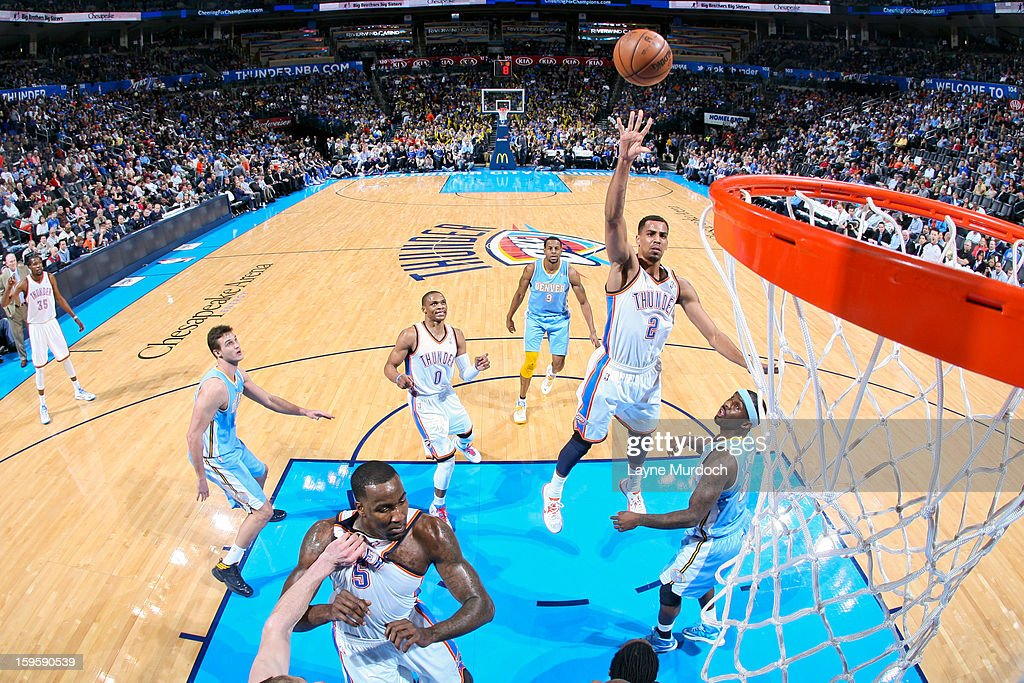 <a gi-track='captionPersonalityLinkClicked' href=/galleries/search?phrase=Thabo+Sefolosha&family=editorial&specificpeople=587449 ng-click='$event.stopPropagation()'>Thabo Sefolosha</a> #2 of the Oklahoma City Thunder shoots in the lane against <a gi-track='captionPersonalityLinkClicked' href=/galleries/search?phrase=Ty+Lawson&family=editorial&specificpeople=4024882 ng-click='$event.stopPropagation()'>Ty Lawson</a> #3 of the Denver Nuggets on January 16, 2013 at the Chesapeake Energy Arena in Oklahoma City, Oklahoma.