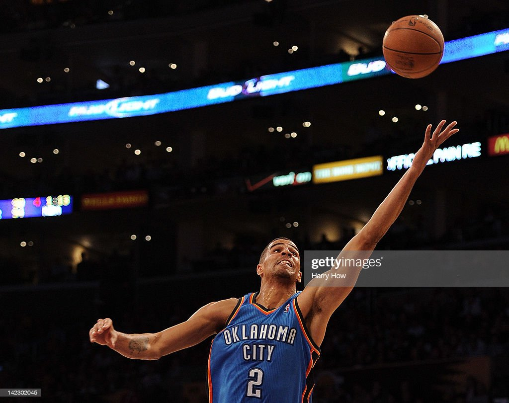 <a gi-track='captionPersonalityLinkClicked' href=/galleries/search?phrase=Thabo+Sefolosha&family=editorial&specificpeople=587449 ng-click='$event.stopPropagation()'>Thabo Sefolosha</a> #2 of the Oklahoma City Thunder stretches for a pass during the game against the Los Angeles Lakers at Staples Center on March 29, 2012 in Los Angeles, California.