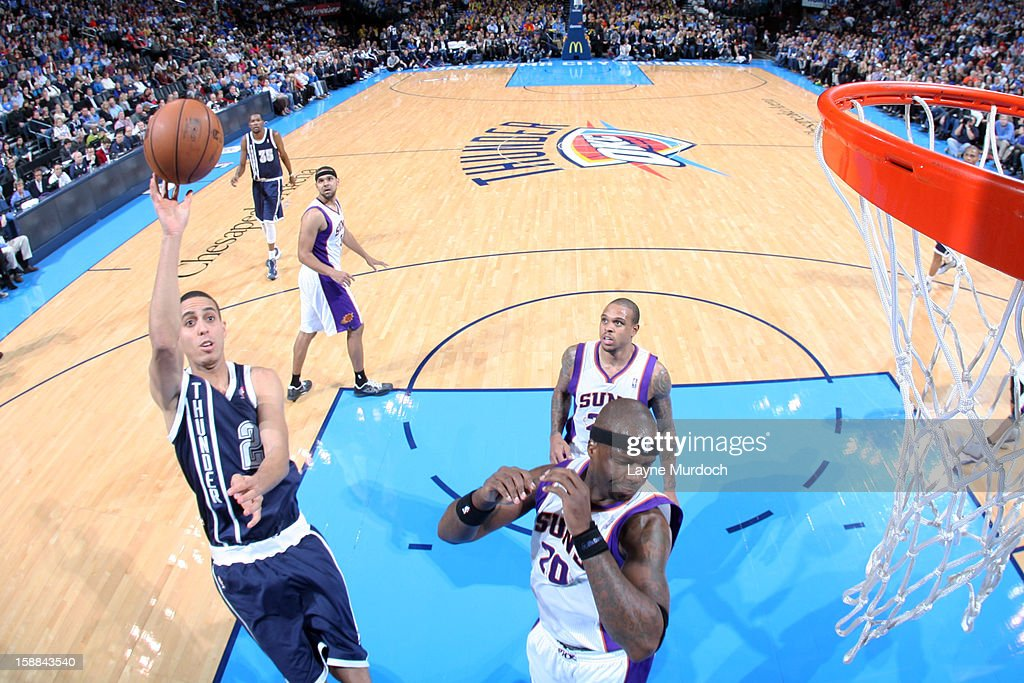 <a gi-track='captionPersonalityLinkClicked' href=/galleries/search?phrase=Thabo+Sefolosha&family=editorial&specificpeople=587449 ng-click='$event.stopPropagation()'>Thabo Sefolosha</a> #2 of the Oklahoma City Thunder takes a close shot against the Phoenix Suns during an NBA game on December 31, 2012 at the Chesapeake Energy Arena in Oklahoma City, Oklahoma.