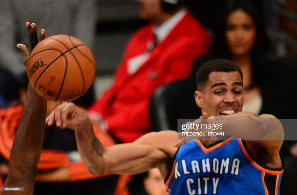 Thabo Sefolosha (R) of the Oklahoma City Thunder vies for a rebound with Metta World Peace (L) of the Los Angeles Lakers on January 11, 2013 at Staples Center in Los Angeles, California. AFP PHOTO / Frederic J. BROWN