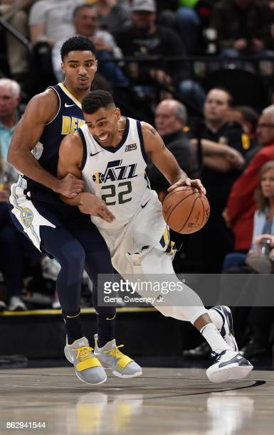 Thabo Sefolosha of the Utah Jazz drives around Gary Harris of the Denver Nuggets in the second half of the 10696 win by the Jazz at Vivint Smart Home...
