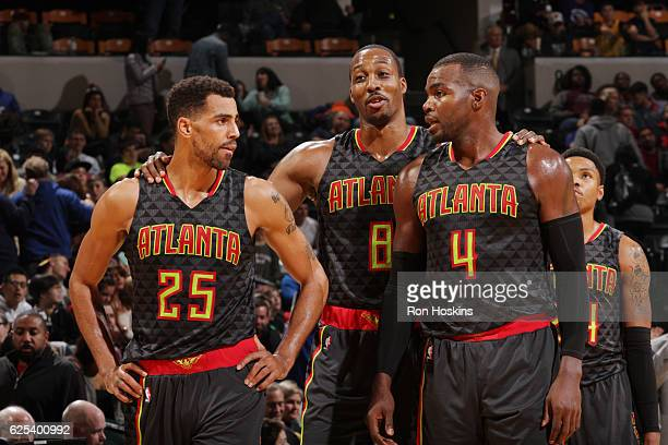 Thabo Sefolosha Paul Millsap and Dwight Howard of the Atlanta Hawks celebrates a win against the Indiana Pacers on November 23 2016 at Bankers Life...
