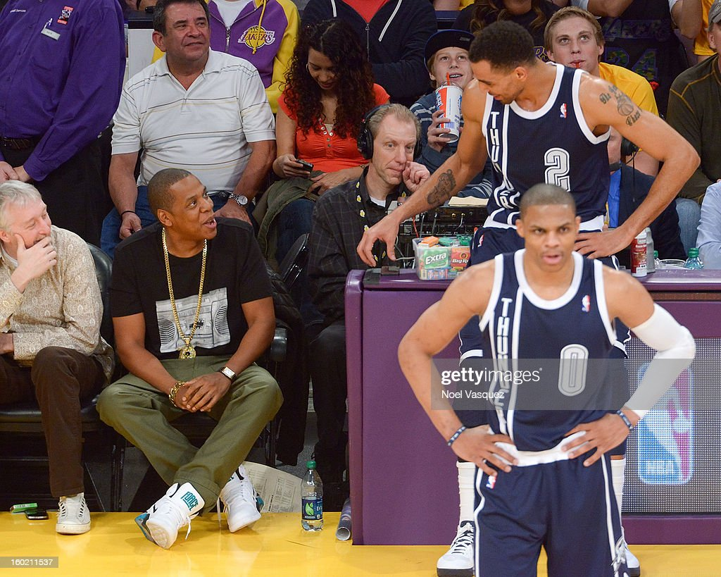 Thabo Sefolosha (R) talks to Jay Z at a basketball game between the Oklahoma City Thunder and the Los Angeles Lakers at Staples Center on January 27, 2013 in Los Angeles, California.