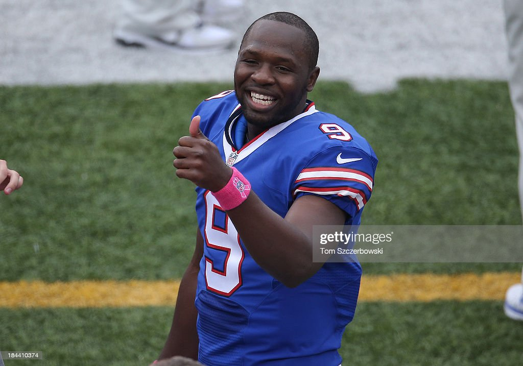 Thad Lewis #9 of the Buffalo Bills gives a thumbs-up before the start of NFL game action against the Cincinnati Bengals at Ralph Wilson Stadium on October 13, 2013 in Orchard Park, New York.
