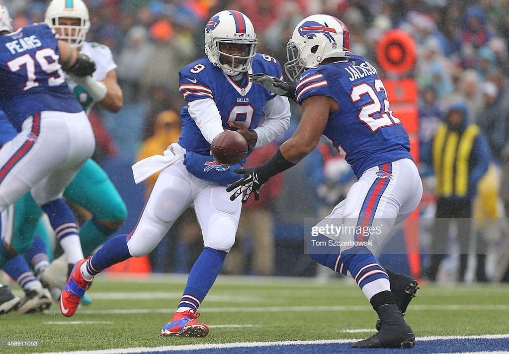 Thad Lewis #9 of the Buffalo Bills hands the ball off to Fred Jackson #22 during NFL game action against the Miami Dolphins at Ralph Wilson Stadium on December 22, 2013 in Orchard Park, New York.