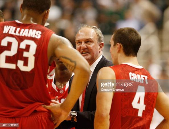 Thad Matta head coach of the Ohio State Buckeyes talks to Aaron Craft and Lenzelle Smith Jr #32 during a second half time out while playing the...