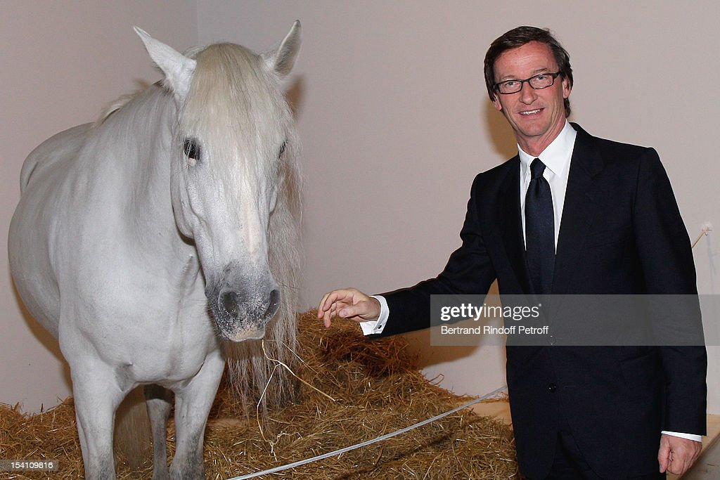 Thaddaeus Ropac poses with a horse as he atttends the opening of his new gallery on October 13, 2012 in Pantin, France.