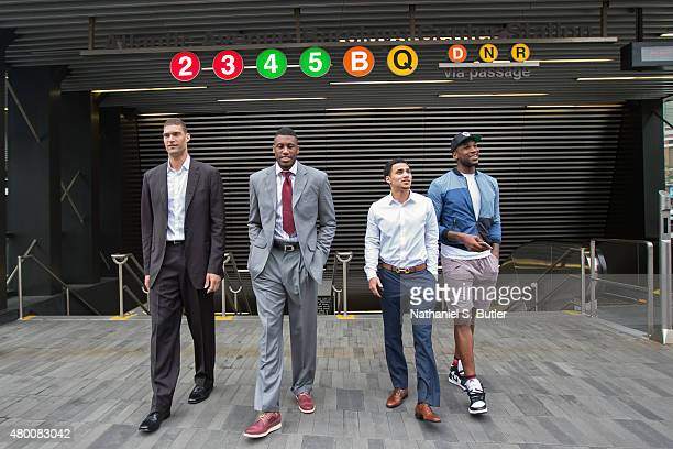 Thaddeus Young Brook Lopez Thomas Robinson and Shane Larkin of the Brooklyn Nets arrive at a press conference via the subway on July 09 2015 at...