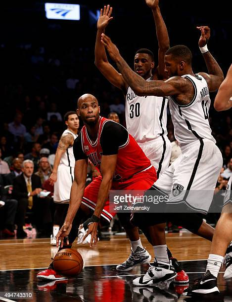 Thaddeus Young of the Brooklyn Nets and Thomas Robinson of the Brooklyn Nets guard Taj Gibson of the Chicago Bulls during a game at Barclays Center...