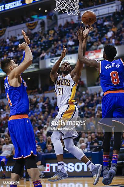Thaddeus Young of the Indiana Pacers shoots the ball against Justin Holiday of the New York Knicks at Bankers Life Fieldhouse on January 23 2017 in...