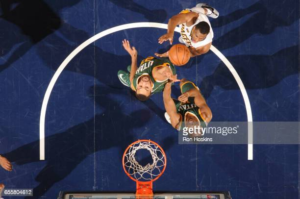 Thaddeus Young of the Indiana Pacers shoots the ball against Rudy Gobert of the Utah Jazz on March 20 2017 at Bankers Life Fieldhouse in Indianapolis...