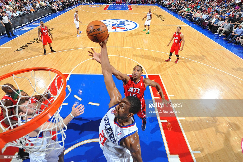 <a gi-track='captionPersonalityLinkClicked' href=/galleries/search?phrase=Thaddeus+Young&family=editorial&specificpeople=3847270 ng-click='$event.stopPropagation()'>Thaddeus Young</a> #21 of the Philadelphia 76ers and <a gi-track='captionPersonalityLinkClicked' href=/galleries/search?phrase=Al+Horford&family=editorial&specificpeople=699030 ng-click='$event.stopPropagation()'>Al Horford</a> #15 of the Atlanta Hawks go up for a rebound at the Wells Fargo Center on April 10, 2013 in Philadelphia, Pennsylvania.