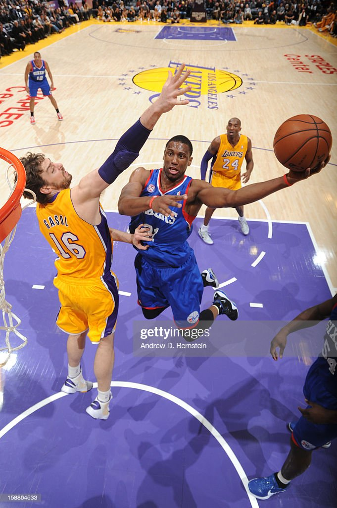 Thaddeus Young #21 of the Philadelphia 76ers attempts a shot against Pau Gasol #16 of the Los Angeles Lakers at Staples Center on January 1, 2013 in Los Angeles, California.