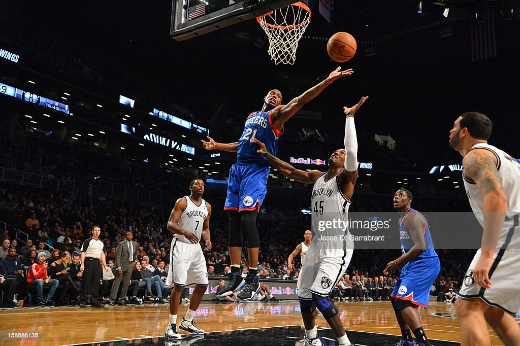 Thaddeus Young #21 of the Philadelphia 76ers attempts to grab the rebound against Gerald Wallace #45 of the Brooklyn Nets during the game at the Barclays Center on December 23, 2012 in Brooklyn, New York.