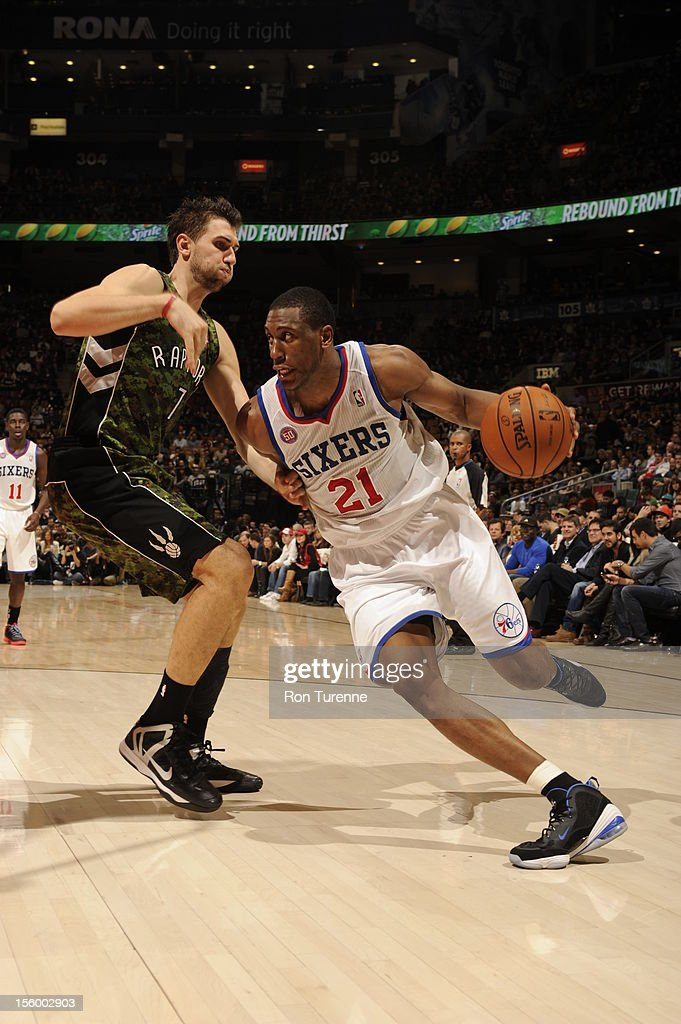 Thaddeus Young #21 of the Philadelphia 76ers drives to the basket against <a gi-track='captionPersonalityLinkClicked' href=/galleries/search?phrase=Andrea+Bargnani&family=editorial&specificpeople=533014 ng-click='$event.stopPropagation()'>Andrea Bargnani</a> #7 of the Toronto Raptors during the game on November 10, 2012 at the Air Canada Centre in Toronto, Ontario, Canada.