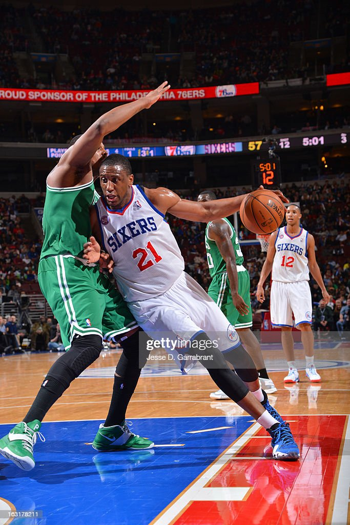 Thaddeus Young #21 of the Philadelphia 76ers drives to the basket against Paul Pierce #34 of the Boston Celtics on March 5, 2013 at the Wells Fargo Center in Philadelphia, Pennsylvania.