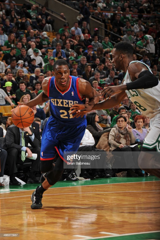 <a gi-track='captionPersonalityLinkClicked' href=/galleries/search?phrase=Thaddeus+Young&family=editorial&specificpeople=3847270 ng-click='$event.stopPropagation()'>Thaddeus Young</a> #21 of the Philadelphia 76ers drives to the basket against Jeff Green #8 of the Boston Celtics on April 4, 2014 at the TD Garden in Boston, Massachusetts.