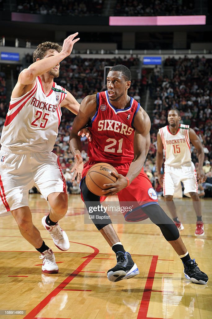 <a gi-track='captionPersonalityLinkClicked' href=/galleries/search?phrase=Thaddeus+Young&family=editorial&specificpeople=3847270 ng-click='$event.stopPropagation()'>Thaddeus Young</a> #21 of the Philadelphia 76ers drives to the basket around <a gi-track='captionPersonalityLinkClicked' href=/galleries/search?phrase=Chandler+Parsons&family=editorial&specificpeople=4249869 ng-click='$event.stopPropagation()'>Chandler Parsons</a> #25 of the Houston Rockets on December 19, 2012 at the Toyota Center in Houston, Texas.