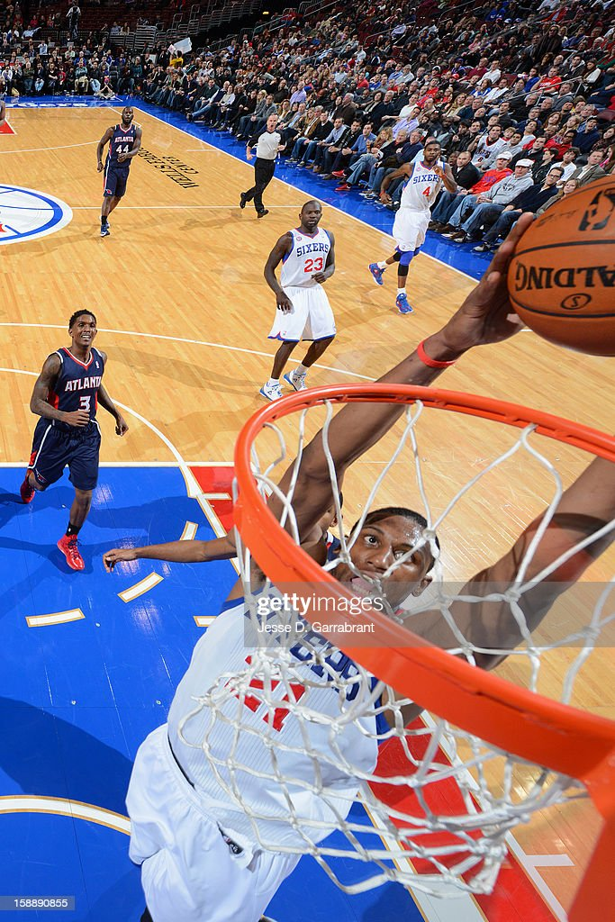 <a gi-track='captionPersonalityLinkClicked' href=/galleries/search?phrase=Thaddeus+Young&family=editorial&specificpeople=3847270 ng-click='$event.stopPropagation()'>Thaddeus Young</a> #21 of the Philadelphia 76ers dunks against the Atlanta Hawks during the game at the Wells Fargo Center on December 21, 2012 in Philadelphia, Pennsylvania.