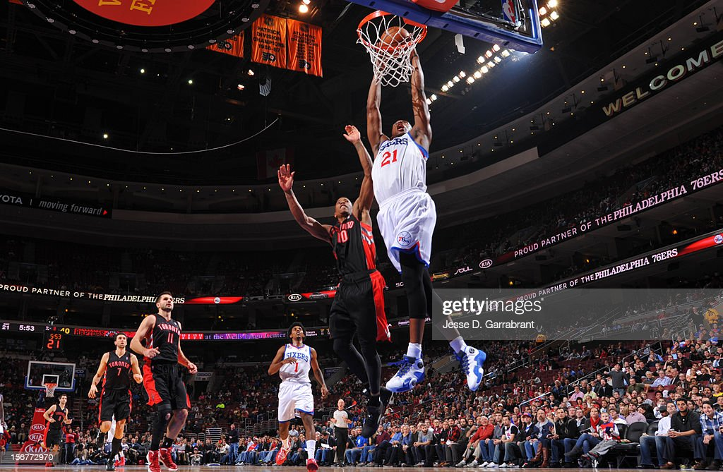 Thaddeus Young #21 of the Philadelphia 76ers dunks the ball against DeMar DeRozan #10 of the Toronto Raptors during the game at the Wells Fargo Center on November 20, 2012 in Philadelphia, Pennsylvania.