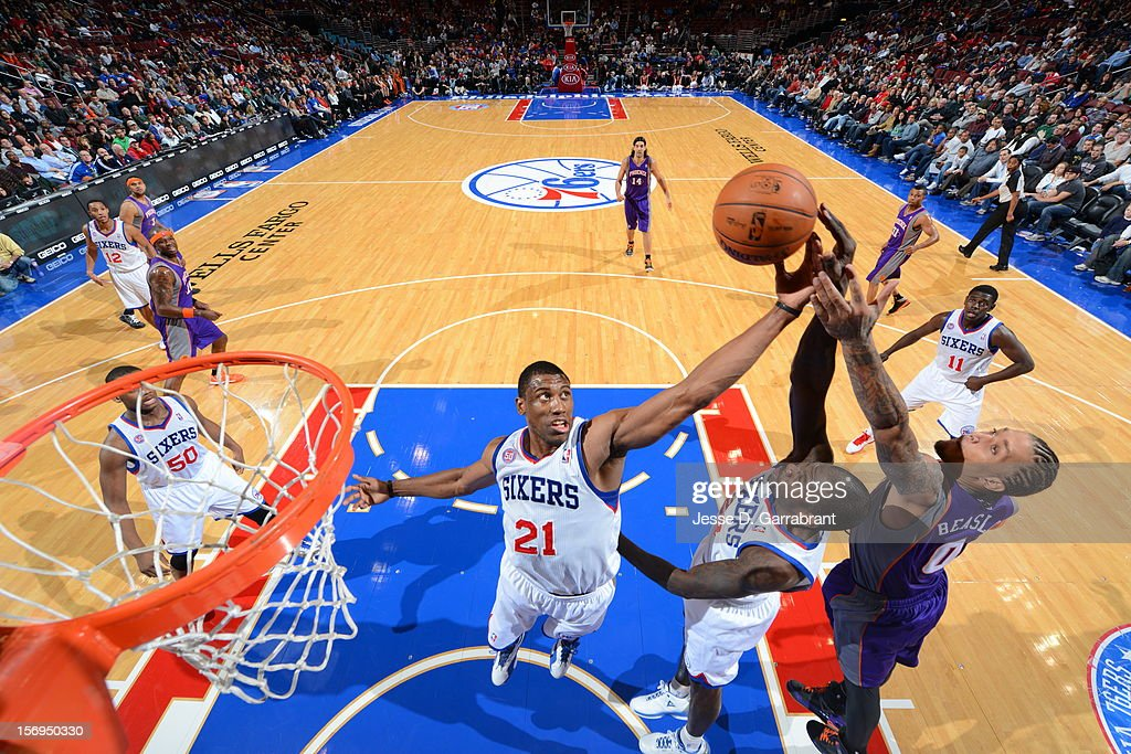 <a gi-track='captionPersonalityLinkClicked' href=/galleries/search?phrase=Thaddeus+Young&family=editorial&specificpeople=3847270 ng-click='$event.stopPropagation()'>Thaddeus Young</a> #21 of the Philadelphia 76ers fights for the rebound against <a gi-track='captionPersonalityLinkClicked' href=/galleries/search?phrase=Michael+Beasley&family=editorial&specificpeople=4135134 ng-click='$event.stopPropagation()'>Michael Beasley</a> #0 of the Phoenix Suns at the Wells Fargo Center on November 25, 2012 in Philadelphia, Pennsylvania.