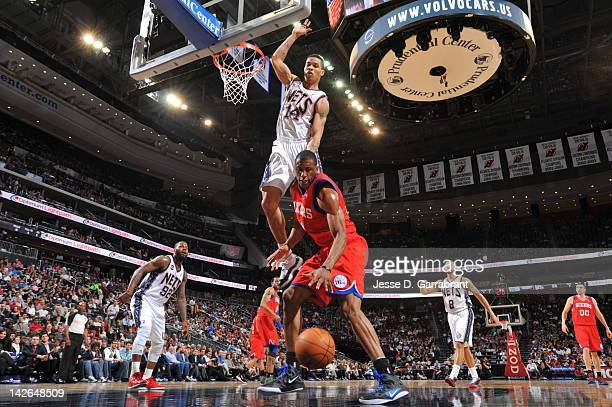 Thaddeus Young of the Philadelphia 76ers goes for the ball against Gerald Green of the New Jersey Nets on April 10 2012 at the Prudential Center in...
