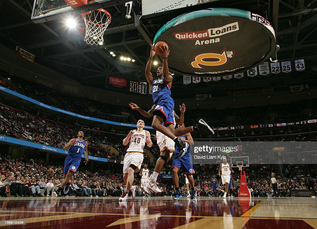 <a gi-track='captionPersonalityLinkClicked' href=/galleries/search?phrase=Thaddeus+Young&family=editorial&specificpeople=3847270 ng-click='$event.stopPropagation()'>Thaddeus Young</a> #21 of the Philadelphia 76ers goes in for the shot against <a gi-track='captionPersonalityLinkClicked' href=/galleries/search?phrase=Tyler+Zeller&family=editorial&specificpeople=5122156 ng-click='$event.stopPropagation()'>Tyler Zeller</a> #40 and <a gi-track='captionPersonalityLinkClicked' href=/galleries/search?phrase=Alonzo+Gee&family=editorial&specificpeople=801443 ng-click='$event.stopPropagation()'>Alonzo Gee</a> #33 of the Cleveland Cavaliers at The Quicken Loans Arena on November 21, 2012 in Cleveland, Ohio.