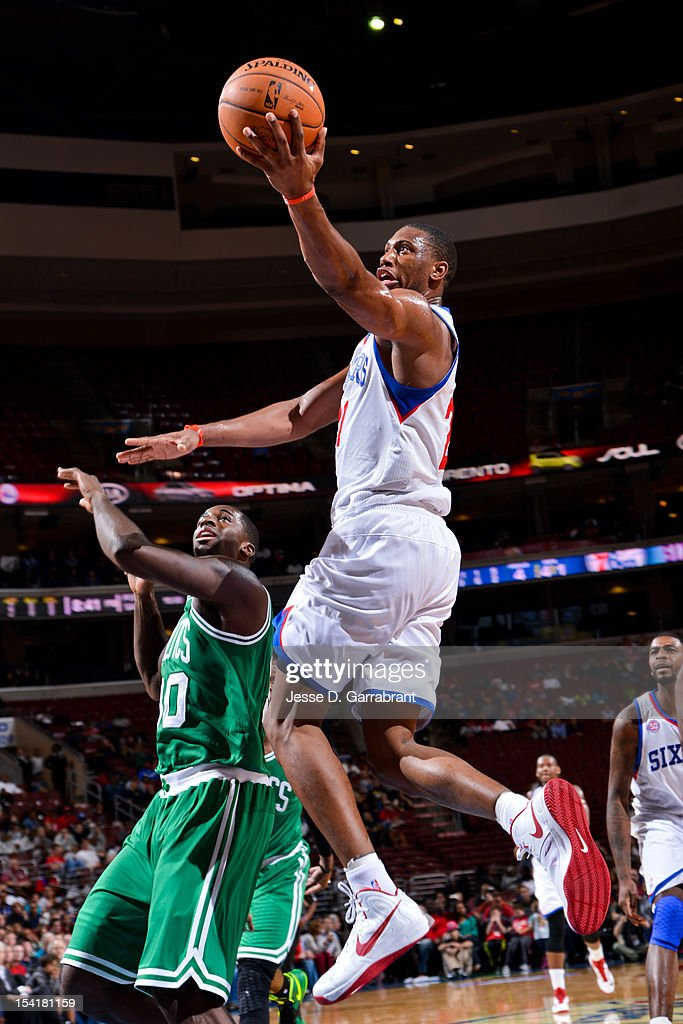 <a gi-track='captionPersonalityLinkClicked' href=/galleries/search?phrase=Thaddeus+Young&family=editorial&specificpeople=3847270 ng-click='$event.stopPropagation()'>Thaddeus Young</a> #21 of the Philadelphia 76ers goes to the basket against the Boston Celtics during a pre-season game at the Wells Fargo Center on October 15, 2012 in Philadelphia, Pennsylvania.