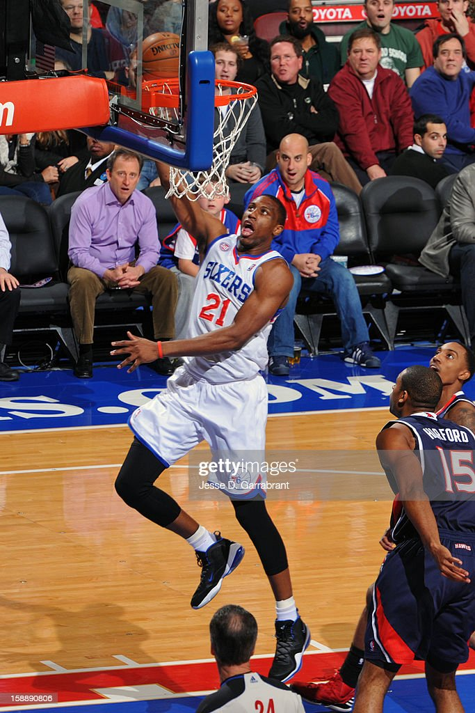 <a gi-track='captionPersonalityLinkClicked' href=/galleries/search?phrase=Thaddeus+Young&family=editorial&specificpeople=3847270 ng-click='$event.stopPropagation()'>Thaddeus Young</a> #21 of the Philadelphia 76ers goes to the basket against <a gi-track='captionPersonalityLinkClicked' href=/galleries/search?phrase=Jeff+Teague&family=editorial&specificpeople=4680498 ng-click='$event.stopPropagation()'>Jeff Teague</a> #0 and <a gi-track='captionPersonalityLinkClicked' href=/galleries/search?phrase=Al+Horford&family=editorial&specificpeople=699030 ng-click='$event.stopPropagation()'>Al Horford</a> #15 of the Atlanta Hawks during the game at the Wells Fargo Center on December 21, 2012 in Philadelphia, Pennsylvania.